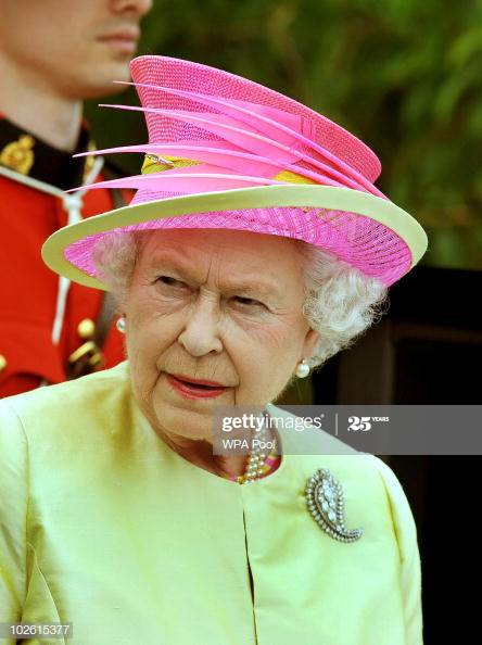 Queen Elizabeth in hot bright pink & lime green hat.