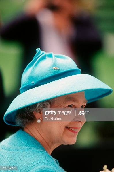 Queen Elizabeth is turquoise aqua blue hat