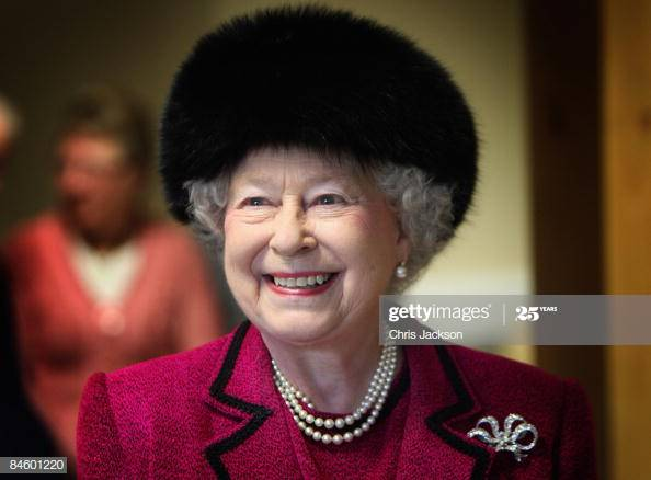 Queen Elizabeth wears a dark brown black fur winter hat